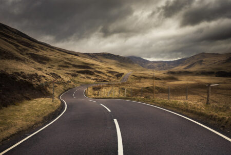 Twisty road in the hills that may lead to financial independence