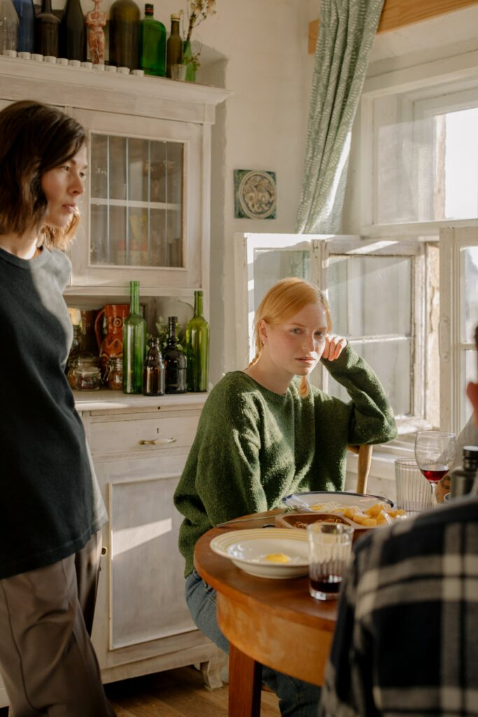 students eating at a table, symbolizing the joint household